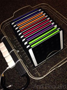A DIY iPad Sync/Charge Station-I like the power strip on the outside of the dish rack