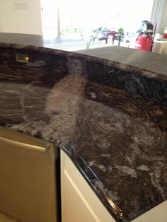 Brass Blue granite with ogee edge.