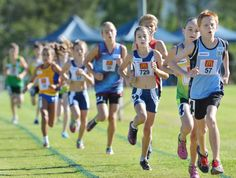 Rory Oliver (57) from Ballina and  Jessica Deans (9) from Coffs Harbour out front  in the 12 Years 1500m boys and  girls' combined race. 310115BSB26