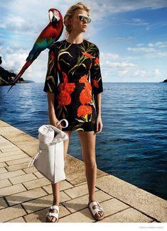 Lara Stone hits the Croatian coast with floral prints. Shot by Mario Testino for Vogue China February 2015