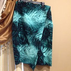 teal blue and black print wrap around skirt Light material great for spring summer. Will ship out today. Worthington Skirts Midi