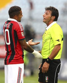 Referee Domenico Celi shows the red card to Kevin Prince Boateng (L) of AC Milan during the Serie A match between Udinese Calcio and AC Milan at Stadio Friuli on September 23, 2012 in Udine, Italy.