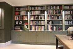Wall to wall bookshelving in Thames Ditton