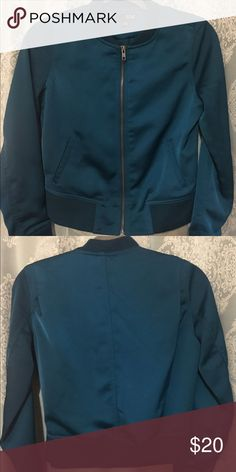 Never worn teal bomber jacket Deep jewel toned teal, never worn bomber jacket. Super chic with a hint of shimmer. Size medium, runs small. a.n.a Jackets & Coats
