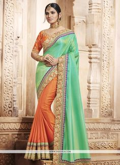 You will be the center of attention in this attire. You are sure to make a effective style statement with this orange and sea green art silk and handloom silk designer half n half saree. The embroider...