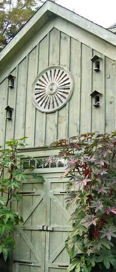A Library of Design: Garden Party: One of the beautiful sage-colored outbuildings at Bunny Williams' weekender home in Connecticut. Looks like it could once have been a carriage house.