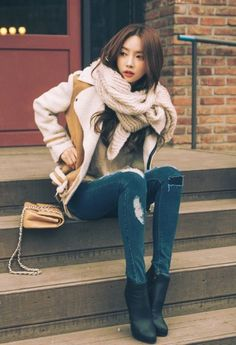 Rtr51gw a south korean girl wears a traditional outfit while fallwinter casual ccuart Choice Image