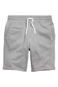 Shorts in soft sweatshirt fabric with an elasticized drawstring waistband and mock fly. Side pockets, one back pocket and sewn cuffs at hems. Sport Shorts, Grey Shorts, Best Thermal Underwear, Camisa Nike, Smart Attire, Fashion Pants, Mens Fashion, Streetwear Shorts, Mens Wool Coats
