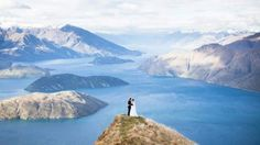 Aerial photograph of Kristy and Corey Rousseau in their wedding outfits on top of a mountain in New Zealand