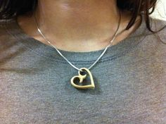 Violin bridge heart necklaces made from old cello and bass bridges.