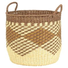 Stow your knitting beside the reading nook arm chair in this woven straw basket, or set it on the hearth to hold kindling and firestarters. ...