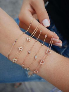 Our 5 mini diamond star chain bracelet features carats of pavé diamond set in gold. Each star measures: Space between each star measures: Total chain length: + extender) Hand Jewelry, Cute Jewelry, Jewelry Box, Jewelery, Vintage Jewelry, Jewelry Armoire, Jewelry Findings, Jewelry Holder, Jewelry Stores