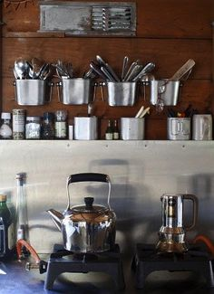 nice simple kitchen set up -- single burners and metal storage cups