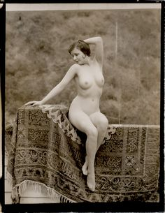 "In provocative figural study pose, sitting nude along the draped balcony which was one of Edwin Bower Hesser's favored locations for shooting his iconic erotic 1920s photography. This vintage first generation still comes from an Allied Artist's Photographers Guild east coast estate. An original graflex photograph taken by Hesser for use in his ""Art's Monthly Pictorial"" photography magazine for artists and art students."