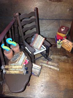 My witch can relax on her rocking chair whilst reading her spell books Spell Books, Haunted Dolls, House Made, Rocking Chair, Witches, Dollhouse Miniatures, Pallet, Relax, Reading