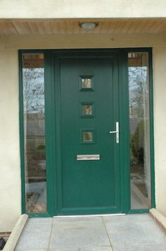 Installation of double diamond front door with middle strip glazing and side panel windows in 28mm double glazing.