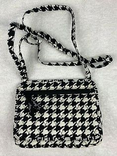 Vera Bradley Quilted Black/White Houndstooth Fabric Crossbody Purse. Purse has adjustable strap and two exterior zippered pockets. Good preowned condition.