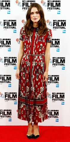 Keira Knightley was all smiles at the Imitation Game photo call during the London Film Festival in a burgundy floral-print pleated ankle-grazing dress, complete with gold-embroidered black pumps.