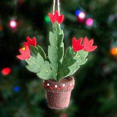 SEWING PATTERN ONLY. Finished products and materials are not included. --------------------------------------------------------------------------------------------------- This pretty little Christmas Cactus Ornament will always be in bloom for the holidays. It's spiky green leaves are accented with colorful red flowers, making it a festive alternative to the traditional poinsettia. The flower pot is decorated with a bit of embroidery for an extra special touch.  My 6-page printable PDF…