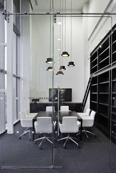 More office inspiration from Net-A-Porter; We just love the Innermost pendant lighting!
