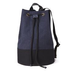 Executed in an industrial, utilitarian blue canvas, this moody bucket bag offers just the right amount of slouch.