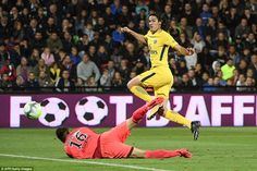Cavani is played through by Thomas Meunier and dinks the ball over the advancing Eiji Kawashima - but it hits the post
