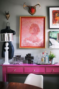 As you travel and grow your home decor collection, your space is sure to change with you. Unique statement pieces like colorful art or abstract trinkets look great against a gray wall. Check out BEHR paint to find your own bold color to add to your home!