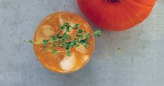 Spice up your fall drinking with this thyme-infused rum-spiked pumpkin cocktail. Get the recipe now!