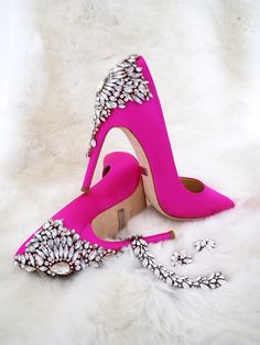 NEW! style from Badgley Mischka Shoes. Say hello to Gorgeous in Carmine Pink. The classic stiletto taken to sparkling new heights in a fabulous HOT PINK shade with pointed toe & rhinestone covered back. Shown with Ben-Amun deco jewelry.