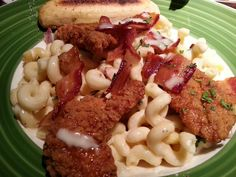 Honey Chicken Tenders over Mac and Cheese with Bacon and Garlic Bread. Applebee's New Braunfels, TX