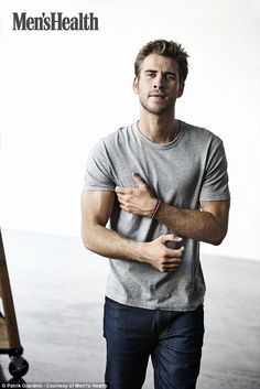Hunky: Liam Hemsworth wasted no time showing off his bulging biceps in a new shoot with Men's Health, which saw him open up about his friendship with The Hunger Games' Jennifer Lawrence and Josh Hutcherson