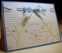 Love the colored embossed part!  And the ribbon treatment.