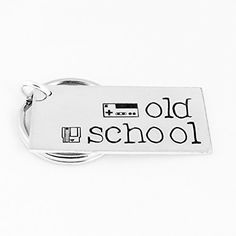 """Old School - Gamer Gift - Video Games - Aluminum Key Chain. This """"Old School"""" aluminum key chain is a great gift for classic gamers. The design is stamped by hand, one letter at a time, including a classic game controller and cartridge stamped near the message. This item is made with an aluminum blank that measures 3/4"""" x 1 1/2"""" in size, with a jump ring attaching a 1"""" split key ring. Please note that due to the nature of hand stamping, every item varies slightly from the photo."""