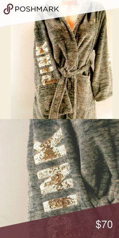 ⚡SALE!!!! Victoria's secret PINK gray bling robe Perfect gift for this holiday season!!BRAND NEW WITH TAGS! VICTORIAS SECRET,PINK COLLECTION DARLING PLUSH Marled gray robe with gold Sequin Bling accent- KNEE LENGTH ROBE SOLD OUT EVERYWHERE!! HOODIE AND TWO FRONT POCKETS 100% POLYESTER Save even more by bundling! Make sure to check out my other NWT item's for your Christmas shopping! Happy poshing! Victoria's secret PINK Intimates & Sleepwear Robes