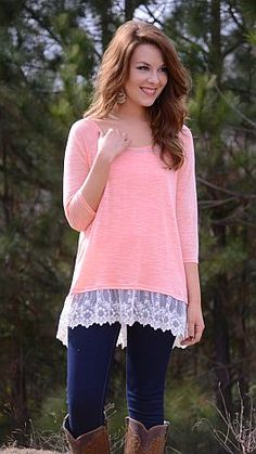 ShopBlueDoor.com: This simple knit top has plenty of flare thanks to that trendy lace hemline! $36
