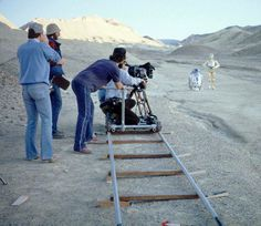 """Anthony Daniels (C-3PO) and Kenny Baker (R2-D2) filming """"Star Wars"""" on location in Tunisia."""