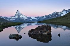Credit to @natgeo : Photo by @shonephoto (Robbie Shone) - Gearing up for next weeks trip to the Alps where we will be joining up with a team of budding young photographers as part of a National Geographic Student Expedition. In the meantime here is a photograph from last years trip overlooking Stellisee with the majestic Matterhorn in the background. This lake is among the most famous of Zermatts lakes. #natgeostudentexpeditions