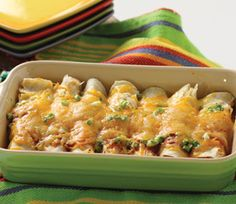 Rotisserie Chicken Enchiladas       1 Pound Rotisserie Chicken, pulled     1 Can Fire-Roasted Chilis, 7 oz., chopped     1 Bunch Green Onions, chopped     4 Cups Enchilada Sauce     1 1/2 Bags Corn Tortillas     2 Cups Shredded Cheese Blend