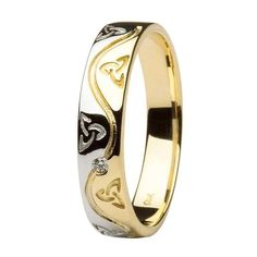 This handcrafted Celtic wedding band has been designed around intricate details and traditional patterns. Interweaving 14 karat white and yellow gold in an complex pattern, the designers at Shanore managed to combine a traditional wedding ring with the famous Trinity knot and a beautifully set diamond.A Steadfast PromiseThe Celtic Trinity Knot is a famous Irish emblem for love, life and faith. The knot celebrates the trinities that are found around us, both spiritually and physically. The…
