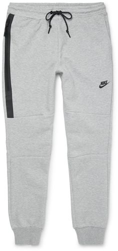 These sweatpants are crafted using Nike 's innovative Tech Fleece - a double-faced jersey that's smooth on both sides and contains a spacer central layer that traps body heat. As a result, they'll keep you warm without adding any bulk or weight. The slim fit and tapered leg mean they'll look great with both casual and sporty outfits. Fits true to size. Take your normal size Slim-tapered leg, low-crotch style These sweatpants are adjustable at the waist Grey cotton-blend Tech Fleece…