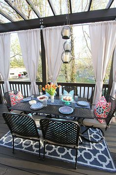 Galvanized Steel Curtain rods & drop cloth drapes -- for a deck! Love this look!