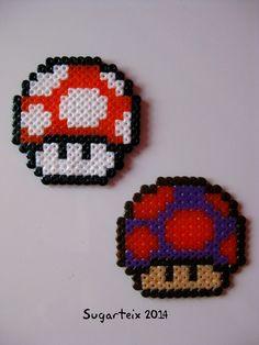 Setas de super Mario Bros en hama mini como llavero, colgante para el cuello, imán y broche. Si te gusta puedes adquirirlo en nuestra tienda on-line: http://www.mistertrufa.net/sugarshop/ Ver más en: http://mistertrufa.net/librecreacion/groups/hama-beads/