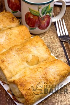 Apples and raisins spiced up with warm cinnamon and layers of flaky buttery pastry make these a real treat. Phyllo dough makes these mini apple strudels easy!