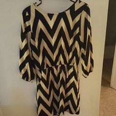 Cute Black and Cream Dress Has pockets, 3/4 sleeves, cinched at the waist! Retrospection Boutique Dresses