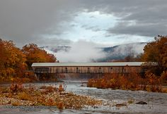 Jeffrey Newcomer West River Crossing  The Dummerston Bridge was coming out of the fog on this autumn morning in Dummerston VT