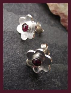 Sterling Silver Flower Studs set with Garnets £23.00