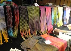 """The Show and Tell table from Pam Howard's class """"Dyeing to Weaving a Scarf"""" April 1-7, 2012. Visit us at www.folkschool.org"""