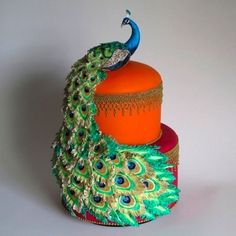 Brightly coloured peacock cake More