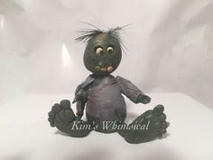 My attempt at a zombie. Came out a little dark.  Handmade by me (Kim's Whimsical Clay: https://www.facebook.com/pages/Kims-Whimsical-Clay/178553212339635)