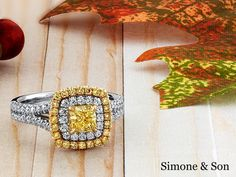 Fancy yellow double halo engagement ring ...awesome natural yellow diamonds.